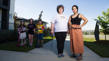 A fire caused by a component of the solar power system in a display home on their street has Denman Prospect residents Lizzie Christiansen and Anita Chatfield worried their homes could burn. Also pictured are Ms Christiansen's children Freyja, 7, Brynn, 11, and Inge, 9.