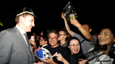 Amazing welcome: All Blacks star Beauden Barrett signs autographs during a New Zealand welcome ceremony at Zojoji Temple in Tokyo.
