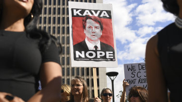 Survivors of sexual assault and members of rights groups rally in Denver against Brett Kavanaugh's nomination to the US Supreme Court.