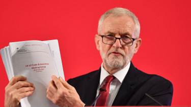 Labour leader Jeremy Corbyn presents documents related to post-Brexit UK-US trade talks which he says will affect the NHS.
