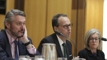 Daniel Crennan, James Shipton and Karen Chester from the Australian Securities and Investments Commission (ASIC) during a hearing with the Standing Committee on Economics at Parliament House in Canberra