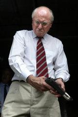 Prime Minister John Howard in the Solomon Islands inspecting some guns that were handed in, 2003.