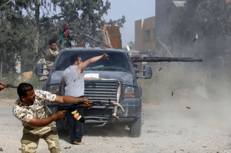 Libyan fighters loyal to the Government of National Accord (GNA) during clashes with forces loyal to strongman Khalifa Haftar south of Tripoli.