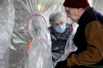 Lynda Hartman, 75, visits her 77-year-old husband, Len Hartman who suffers from dementia and coronavirus.