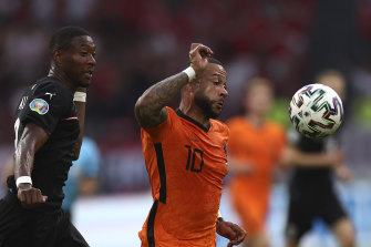 Memphis Depay, right, scored the opener for the Dutch from the spot after 10 minutes against Austria.
