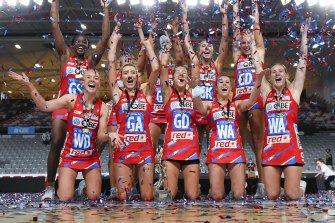 The Swifts celebrate their grand final victory over the Giants.