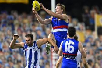 Alex Keath of the Bulldogs marks over the top of Ben Cunnington.