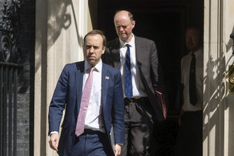 Britain's Health Secretary Matt Hancock (left) and Chief Medical Officer Chris Whitty outside 10 Downing Street on May 4.