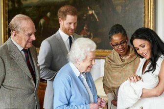 Prince Harry and Meghan, joined by her mother Doria Ragland, introduce Archie to the Queen and Prince Philip in 2019.