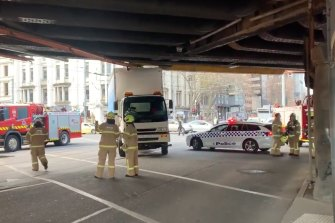 Sections of Melbourne's rail network have been thrown into chaos after a truck was wedged under a rail bridge on Tuesday.