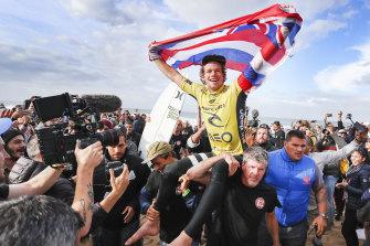 John John Florence celebrating after winning the 2016 World Surf League title.