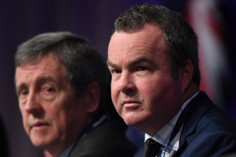 Outgoing Victorian Liberal director Simon Frost sits with state president Robert Clark at the party's state conference in June