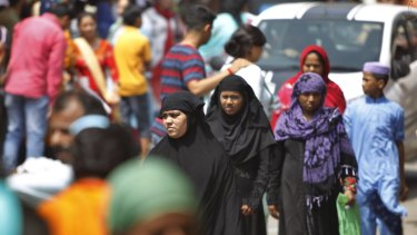 People throng a market on the eve of Eid al Adha in Jammu on Sunday.
