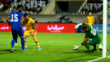 First blood: Matthew Leckie scores the opening goal at Kuwait Club Stadium.