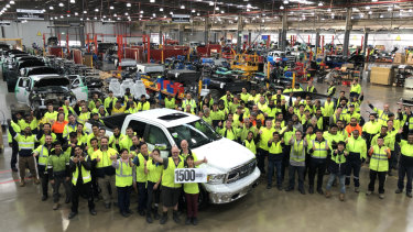 Workers celebrate production of the 1500th Ram pick-up truck.
