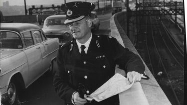 The Police Traffic Chief, Superintendent M. W. Chaseling, watches the flow of traffic over the Harbour Bridge  as the North side change-over from trams to buses received its first main test. July 1, 1958.