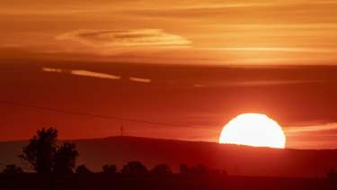 The sun rises in Frankfurt, Germany.