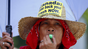 A woman blows her whistle during a protest outside the Canadian Embassy last week.