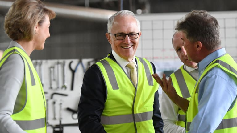 Malcolm Turnbull and Michaelia Cash chatting to Michael Kennedy of Kennedy's Timber in Narangba, Brisbane.
