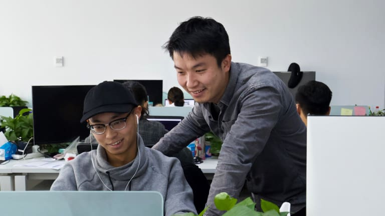 Peng Zehuan, right, co-founder of FEED Tech, with a colleague in their office in Beijing.