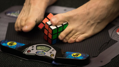 'A bit of a freak show': The novel way these kids solve Rubik's Cubes, in seconds