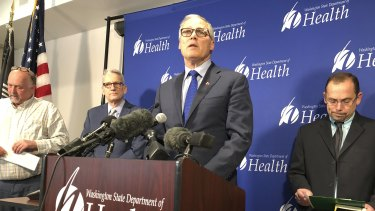 Washington Governor Jay Inslee, centre, speaking after a man in Washington state is identified as the first known person in the United States to catch a new type of coronavirus that officials believe originated in China.