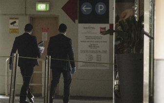 NSW Police arrive at the Novotel Darling Harbour on Thursday morning. The location is one of two hotels where the infected woman worked.