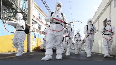 Soldiers spray disinfectant as a precaution against the coronavirus in Gyeongsan, South Korea.