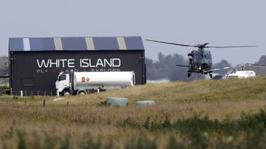 A navy helicopter returns to Whakatane Airport following the recovery operation to retrieve victims.