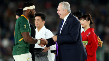 Bill Beaumont, right, has won a second term as World Rugby chairman.
