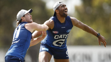 Esava Ratugolea battled with Cats recruit Jack Steven as training on Tuesday.