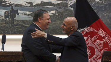 US Secretary of State Mike Pompeo, left and Afghan President Ashraf Ghani, shake hands after a press conference at the presidential palace in Kabul on July 9.