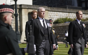 Prince Andrew walks behind his father's coffin on Saturday.