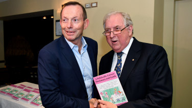 Former prime minister Tony Abbott greets author Kevin Donnelly during the book launch in Sydney.