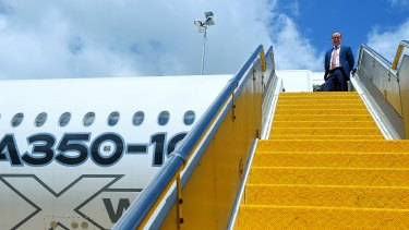 Alan Joyce on the steps of an A350-1000 during a test flight in Sydney in February.