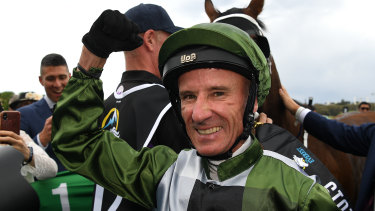 Glen Boss celebrates after guiding Yes Yes Yes to victory in The Everest.