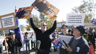 Rival groups clash outside the George Pell hearing at the High Court in Canberra.