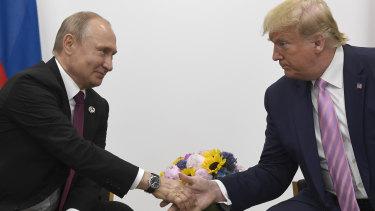 Russian President Vladimir Putin shakes hands with US President Donald Trump in 2019.