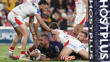 Nelson Asofa-Solomona goes over near the posts for the Storm at Suncorp Stadium.
