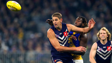 Aaron Sandilands battles long-time ally Nic Naitanui in this year's derby ... the 211cm giant announced his retirement on Tuesday.
