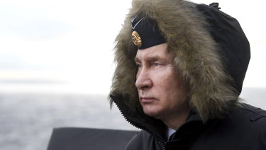 Russian President Vladimir Putin watches a navy exercise from the Marshal Ustinov missile cruiser in the Black Sea, Crimea, in January.