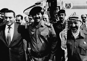 President Saddam Hussein, centre, greets President Hosni Mubarak, left, and Palestinian Liberation Organisation Chairman Yasser Arafat for talks aimed at a coordinated Arab position on Middle East peace, 1988.