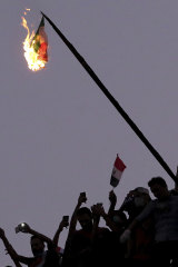 Iraqi Anti-government protesters burn the Iranian flag during a demonstration in Baghdad, Iraq.