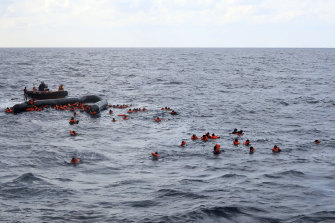 Rescuers come to the aid of migrants after one of the shipwrecks this week.