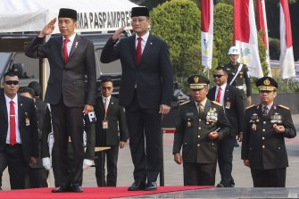 Former Indonesian social affairs minister Juliari Batubara, right, with President Joko Widodo. Juliari was jailed for corruption last month.