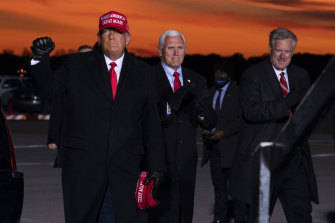 Donald Trump's chief of staff Mark Meadows, on the right, pictured with Trump and vice-president Mike Pence on November 2, 2020.