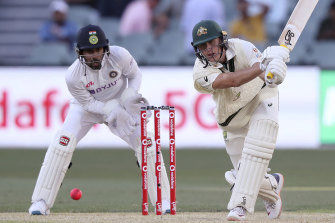 Marnus Labuschagne plays a shot in front of India's Wriddhiman Saha.