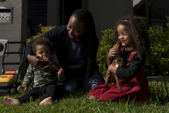 Dr Tinashe Moira Dune, an academic at Western Sydney University, with her children, Naya and Yarran.