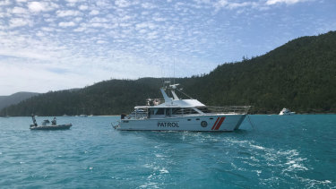 Queensland Boating and Fisheries boats patrolling Cid Harbour on Friday.