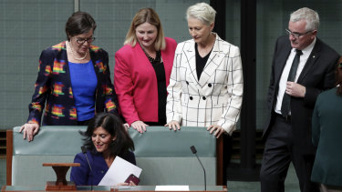 Ms Banks, who made her speech to a near-empty House of Representatives, was later surrounded by other crossbenchers.